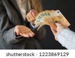 woman demanding bribe money | Shutterstock . vector #1223869129
