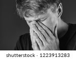 stressed and sad man covering...   Shutterstock . vector #1223913283