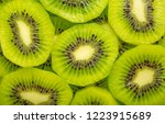 kiwi closeup as background.... | Shutterstock . vector #1223915689