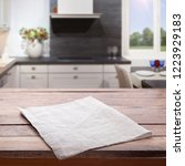 kitchen towel on empty wooden... | Shutterstock . vector #1223929183