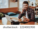 guy in headphones uses... | Shutterstock . vector #1224001900