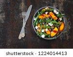 healthy salad with persimmon ...   Shutterstock . vector #1224014413