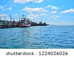 fishing boat parked at the pier ... | Shutterstock . vector #1224026026