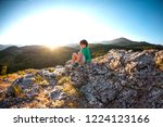 boy at the top of the mountain... | Shutterstock . vector #1224123166