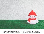 snowman in knitted cap and red... | Shutterstock . vector #1224156589
