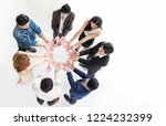 Small photo of Creative team meeting hands together in circle, top view asian caucasian people family teamwork unity acquisition, brainstorm business multicultural people concept. Startup friends people project