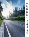 the highway is in green forest. | Shutterstock . vector #1224243019
