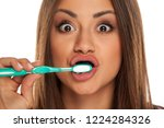 young woman brushing her teeth... | Shutterstock . vector #1224284326