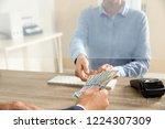 man giving money to teller at... | Shutterstock . vector #1224307309