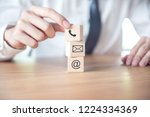 contact us  businessman hand... | Shutterstock . vector #1224334369