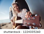 tuning the guitar. close up of... | Shutterstock . vector #1224335260