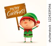 little elf holds a wooden board ... | Shutterstock .eps vector #1224339346