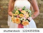 bride holding her bouquet | Shutterstock . vector #1224353506