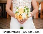 bride holding her bouquet | Shutterstock . vector #1224353536