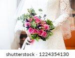 bride holding her bouquet | Shutterstock . vector #1224354130