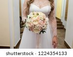 bride holding her bouquet | Shutterstock . vector #1224354133