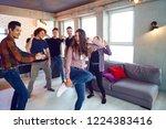 friends dance fun at a student... | Shutterstock . vector #1224383416