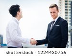 two young businessman are shake ... | Shutterstock . vector #1224430756