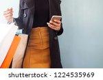 woman wearing black overcoat... | Shutterstock . vector #1224535969