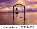 Young Woman Swinging On A Swin...