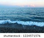 waves with foam on the beach....   Shutterstock . vector #1224571576
