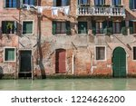 old brick buildings and painted ... | Shutterstock . vector #1224626200