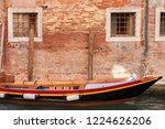 red wooden boat moored in front ... | Shutterstock . vector #1224626206