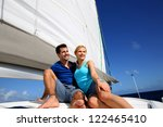 portrait of couple sitting on... | Shutterstock . vector #122465410
