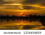 sunset over water in red ... | Shutterstock . vector #1224654829
