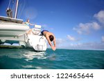 Man Diving From Catamaran Deck...