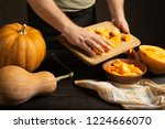 cook throws slices of pumpkin... | Shutterstock . vector #1224666070