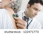 male doctor examining patient's ... | Shutterstock . vector #122471773