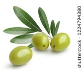 Small photo of Ripe green olives with leaves, isolated on white background