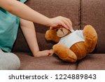 a small plush teddy bear...   Shutterstock . vector #1224889843