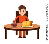 boy eating breakfast in the... | Shutterstock .eps vector #1224953473