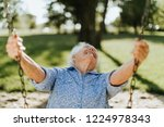 cheerful senior woman on a... | Shutterstock . vector #1224978343