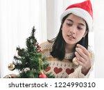 happy asian woman wearing red... | Shutterstock . vector #1224990310