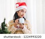 asian woman wearing santa hat... | Shutterstock . vector #1224993220