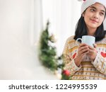 asian woman wearing santa hat... | Shutterstock . vector #1224995539