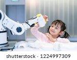 asian little girl touching a... | Shutterstock . vector #1224997309
