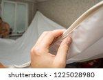 repairmen install stretch... | Shutterstock . vector #1225028980