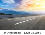 asphalt road and mountains at... | Shutterstock . vector #1225031059