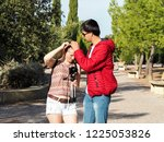 a couple walking with a camera  ... | Shutterstock . vector #1225053826