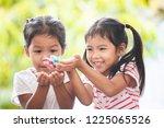 two asian child girls having... | Shutterstock . vector #1225065526