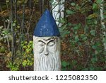 grumpy looking wooden gnome... | Shutterstock . vector #1225082350