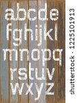 alphabet white color paint on... | Shutterstock .eps vector #1225101913