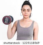 teen model poses on white in... | Shutterstock . vector #1225118569