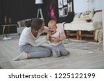 mother comforts a crying baby... | Shutterstock . vector #1225122199