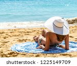 young woman with white hat... | Shutterstock . vector #1225149709