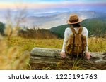 woman traveler with backpack... | Shutterstock . vector #1225191763